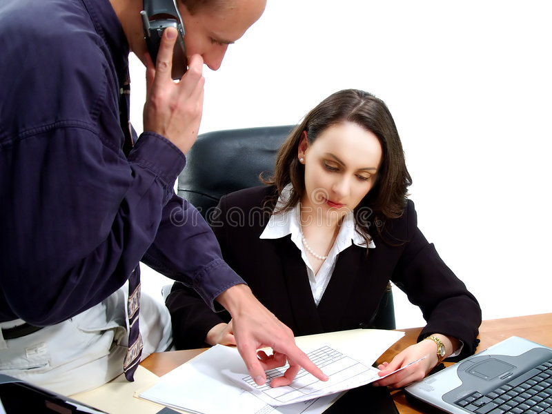 Business People 14. Businessman and businesswoman conducting an executive business meeting