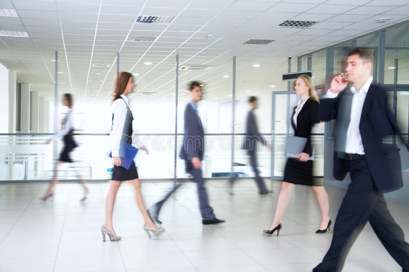 Business people. Walking in the office corridor royalty free stock images