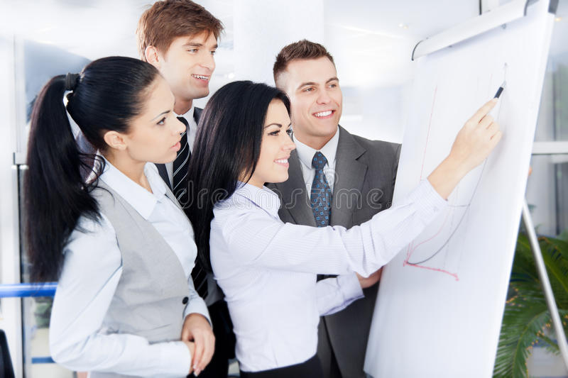 Business people. Group of business people team looking draw chart on white board,woman explaining graph diagram on whiteboard to colleagues in office royalty free stock images