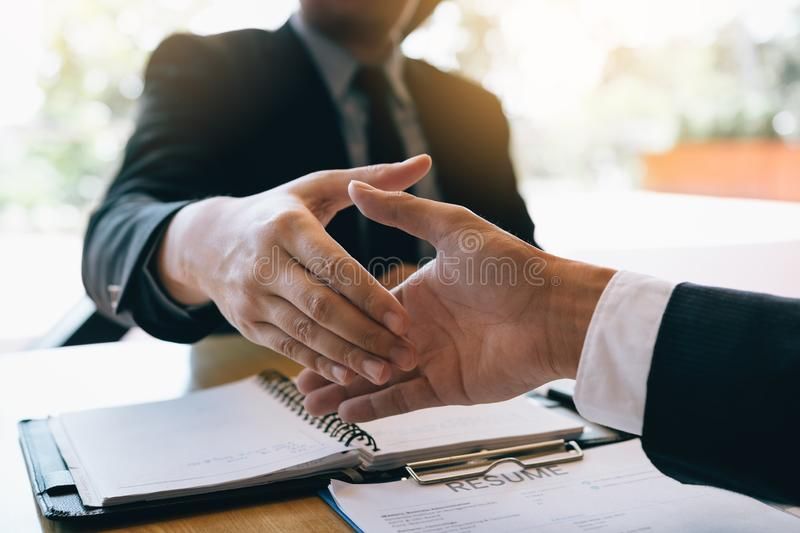 Business people accept or confirm project on the proposal and join shaking hands at office.  stock photos