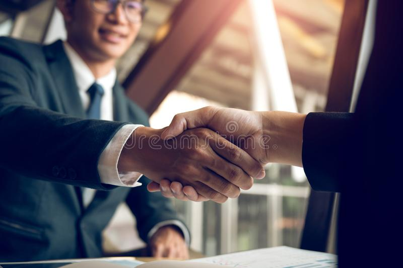 Business people accept or confirm project on the proposal and join shaking hands at office room company royalty free stock photos