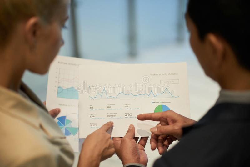 Business people analyzing data royalty free stock photography