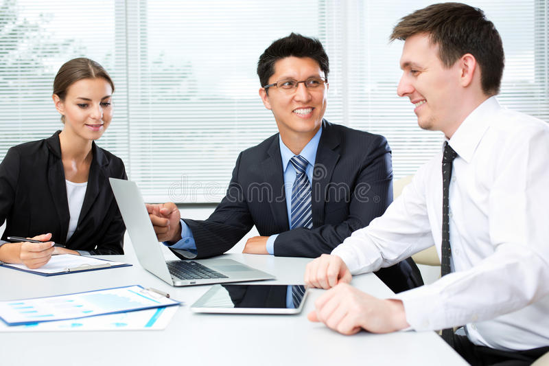 Business people. Analyzing and discussing during a working meeting in a modern office stock photography
