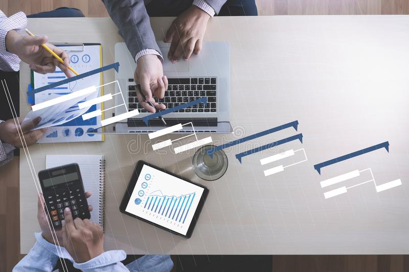 Business People Analyzing PROJECT MANAGEMENT updating Gantt cha royalty free stock photo