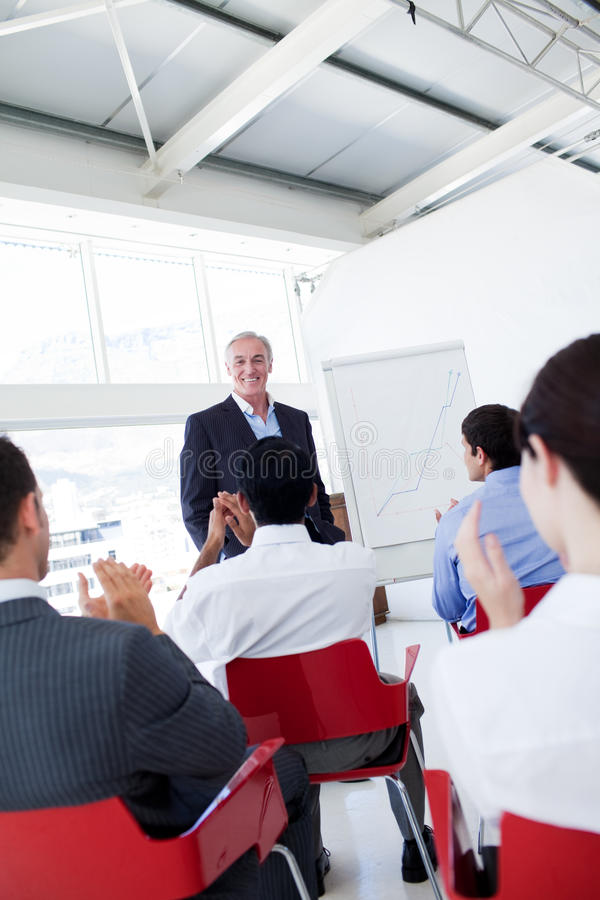 Business people applauding a conference