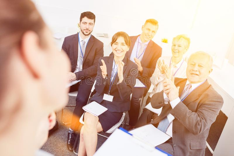 Business people clap hands. Business people as audience clap hands after business workshop royalty free stock images