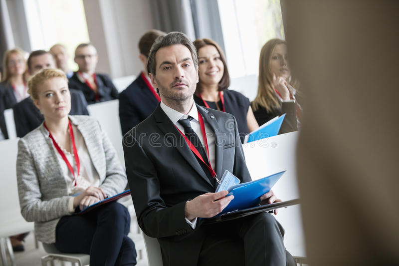 Business people attending seminar at convention center royalty free stock images
