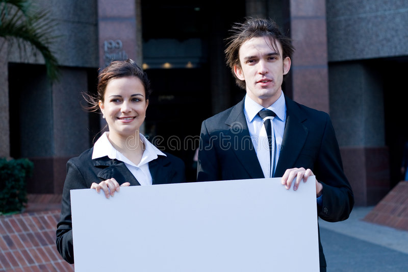 Business people with banner