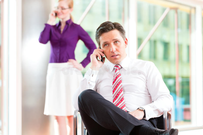 Business people - boss and secretary in office royalty free stock photos