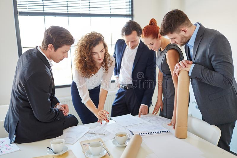 Business people brainstorming and planning royalty free stock photography