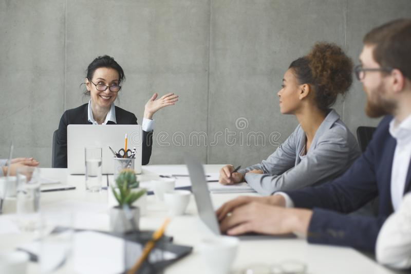 Business people brainstorming together in the meeting room. Boss talking to employes royalty free stock images