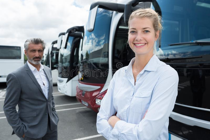 Business people in bus garage stock photos