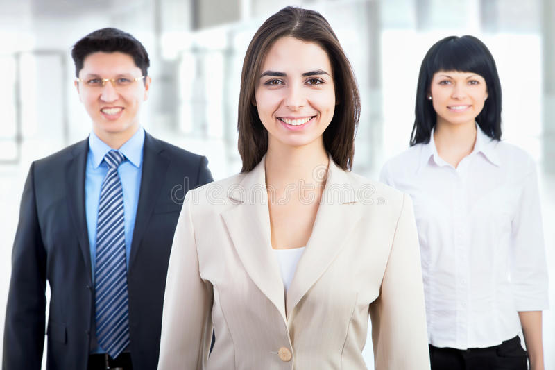 Business people with businesswoman leader. Group of business people with businesswoman leader on foreground royalty free stock images