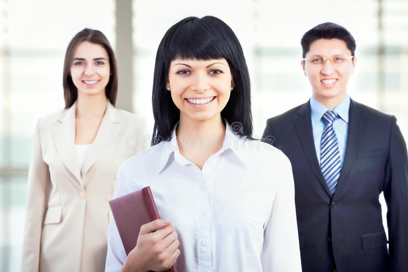Business people with businesswoman leader. Group of business people with businesswoman leader on foreground stock photography