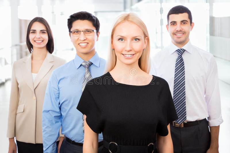 Business people with businesswoman leader. Group of business people with businesswoman leader on foreground stock images
