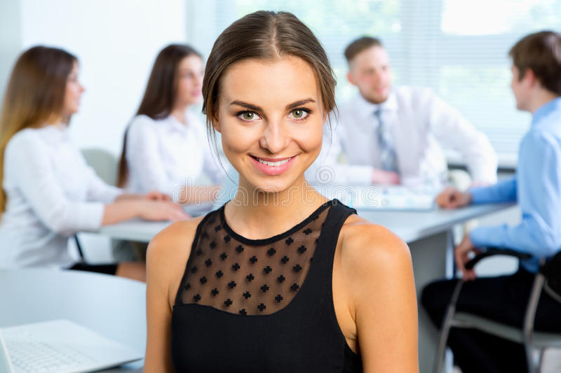Business people with businesswoman leader. Group of business people with businesswoman leader on foreground royalty free stock photography