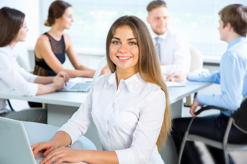 Business people with businesswoman leader. Group of business people with businesswoman leader on foreground stock photo
