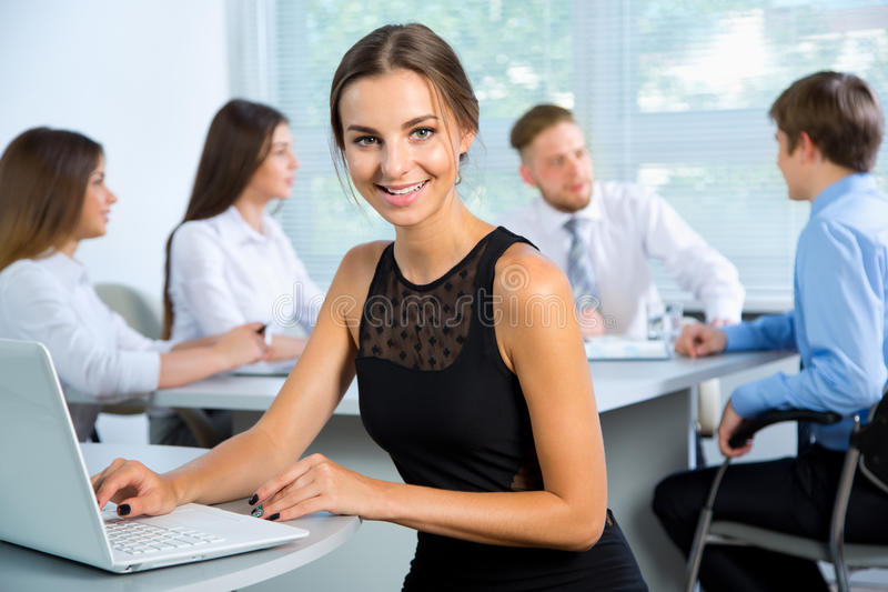 Business people with businesswoman leader. Group of business people with businesswoman leader on foreground stock photos
