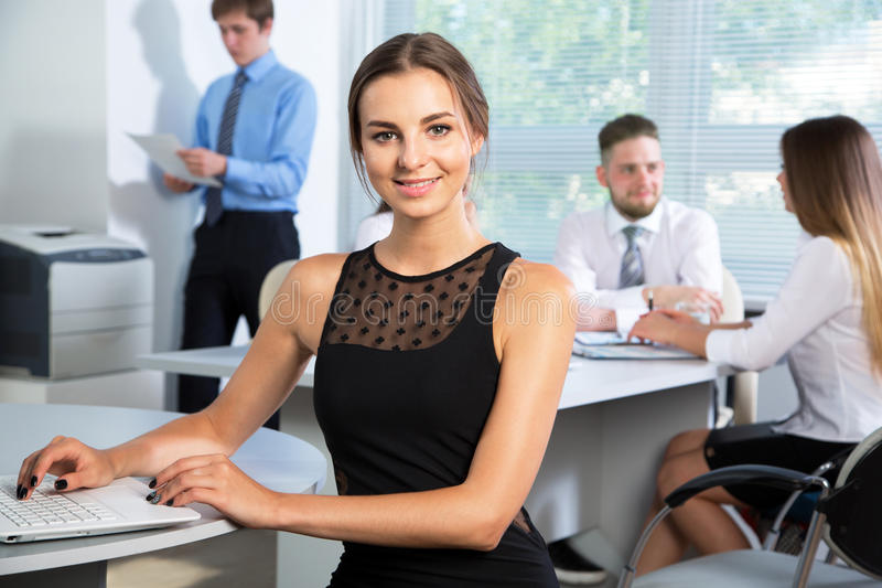 Business people with businesswoman leader. Group of business people with businesswoman leader on foreground royalty free stock photos