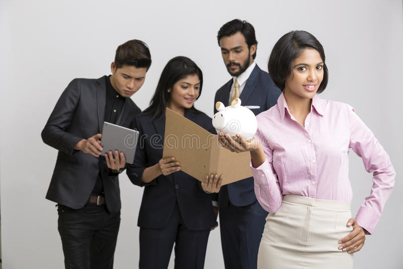 Business people with businesswoman leader with piggy bank royalty free stock images