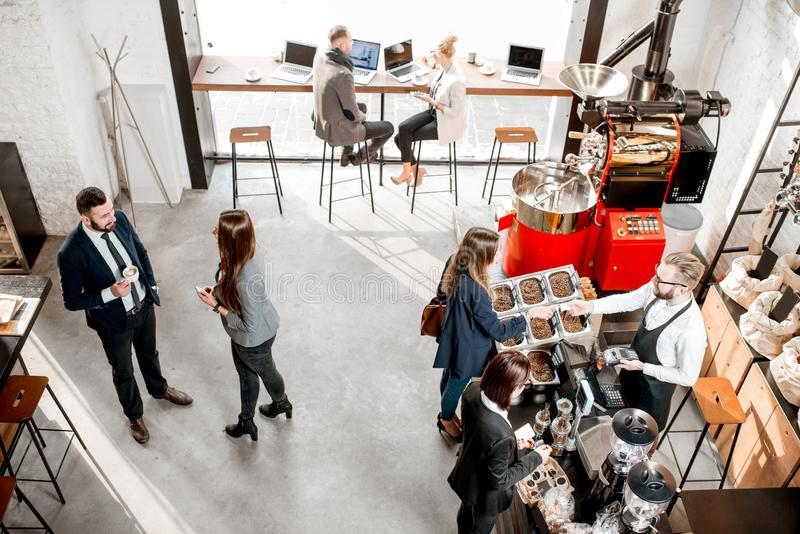 Business people in the cafe. Business people talking and having fun durnig a coffee time in the modern cafe interior. Wide view from above royalty free stock image