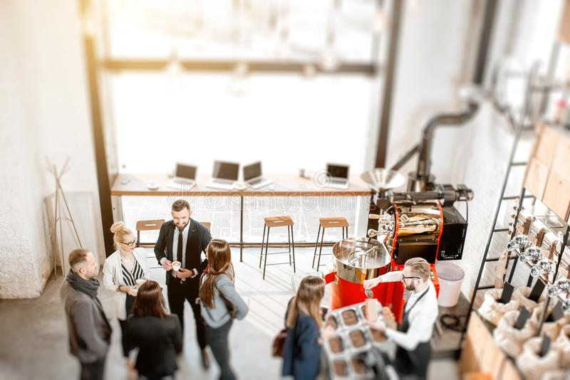 Business people in the cafe. Business people talking and having fun durnig a coffee time in the modern cafe interior. Wide view from above tilt shift effect stock photo