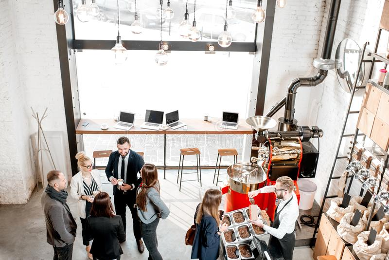Business people in the cafe. Business people talking and having fun durnig a coffee time in the modern cafe interior. Wide view from above royalty free stock photo