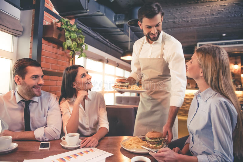 Business people in cafe stock photos