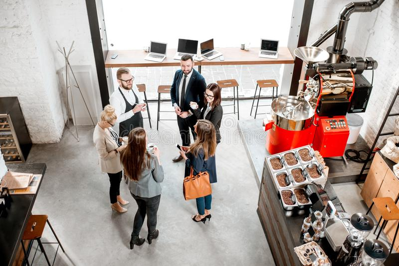 Business people in the cafe. Business people talking and having fun durnig a coffee time in the modern cafe interior. Wide view from above royalty free stock images