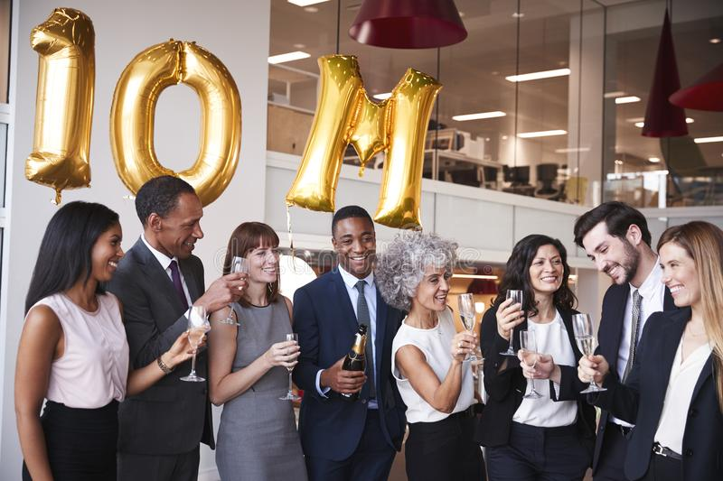 Business people celebrate meeting target in the office royalty free stock images