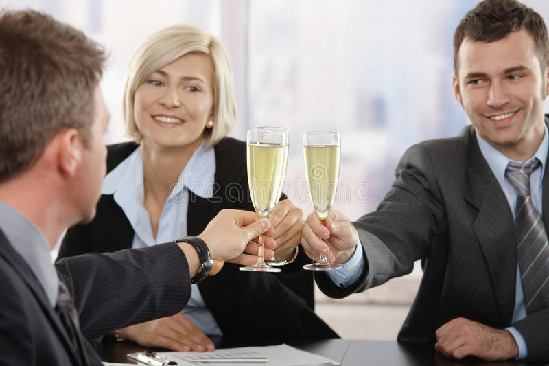 Business people celebrating with champagne royalty free stock image