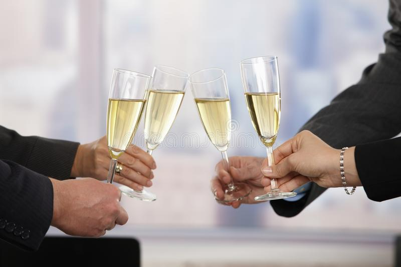 Business people celebrating with champagne stock images