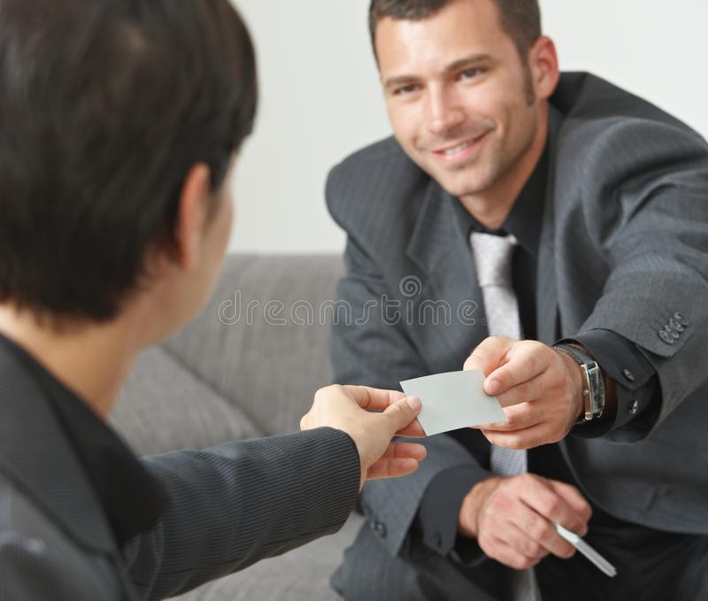 Business people changing cards stock images