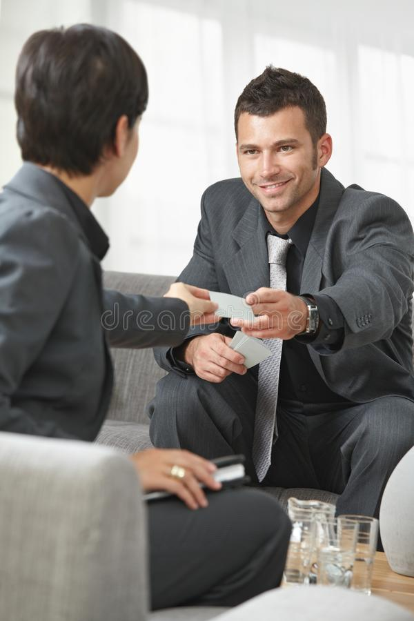 Business people changing cards stock photo