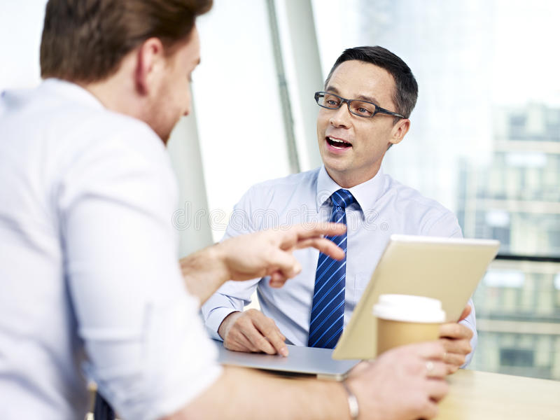 Business people chatting in office stock images