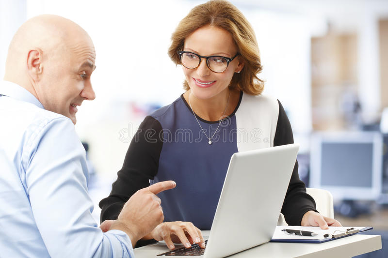 Business people. Chief financial officer analyzing financial data with business woman. Teamwork at office royalty free stock photo