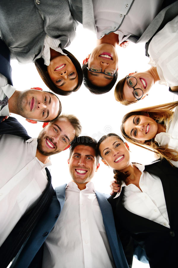 Business people in a circle looking down royalty free stock photography