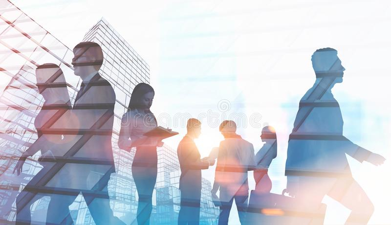 Business people in a city, finance concept. Business people silhouettes. A foggy city background. Concept of a modern company lifestyle. Toned image double stock photography