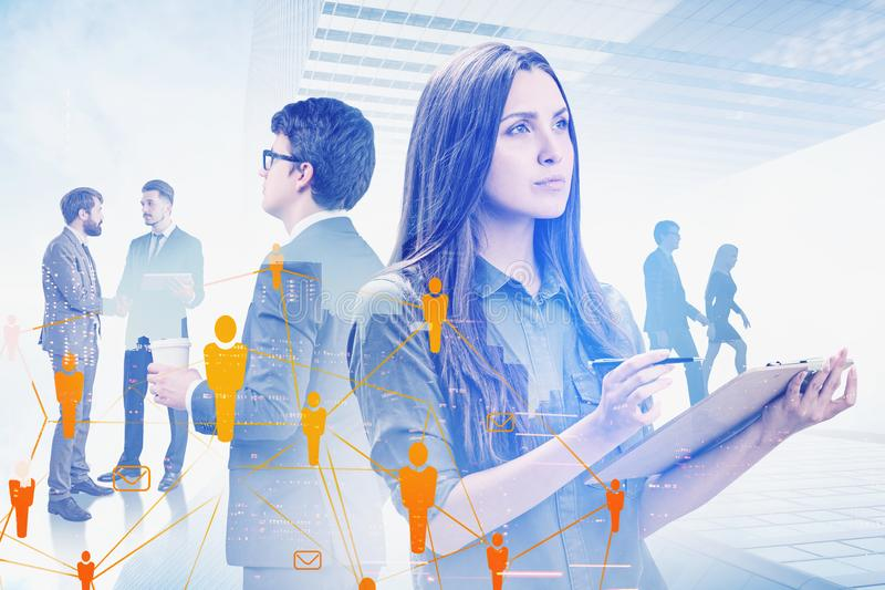 Business people in city, HR icons. Young inspired business people in abstract city with double exposure of HR icons. Concept of social connection and network in stock photo