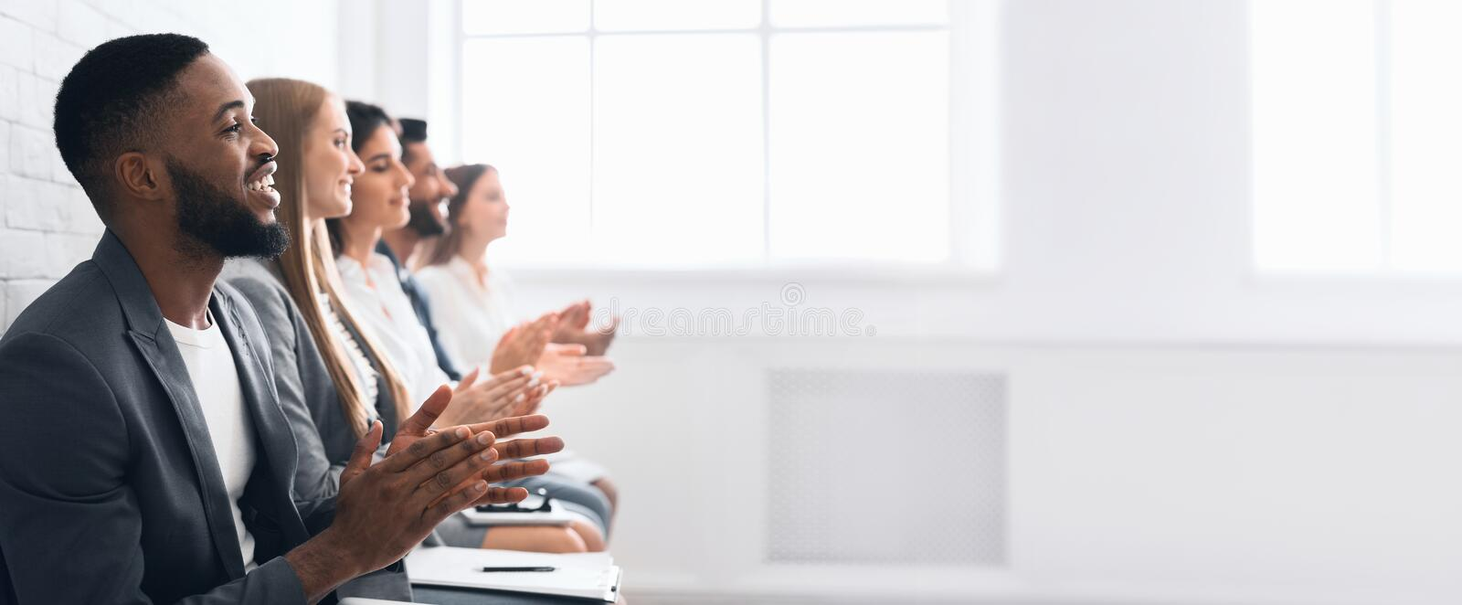 Business people clapping hands after business seminar stock photography