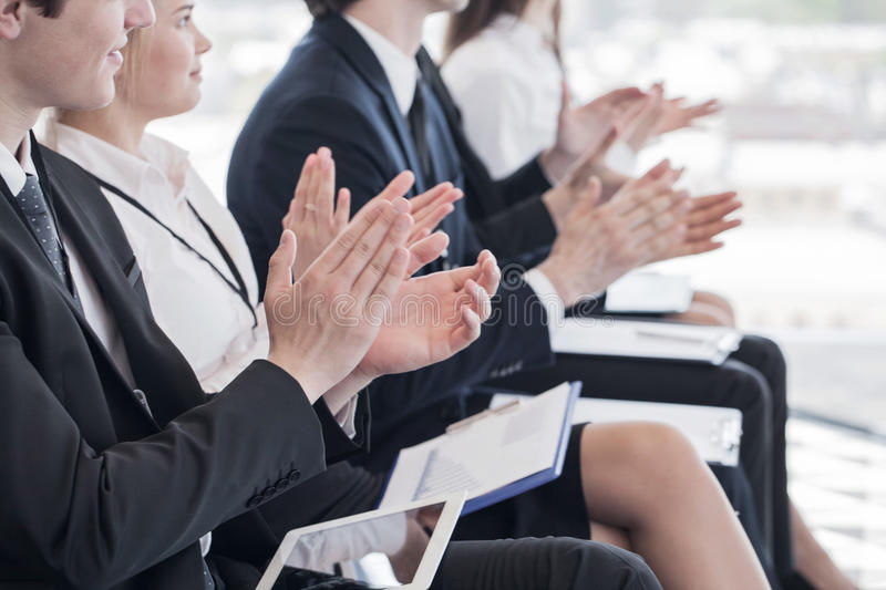 Business people clapping hands. Happy business group of people clapping hands during a meeting conference royalty free stock photos