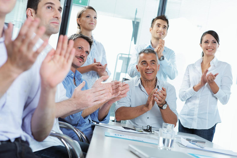 Business people clapping in a meeting royalty free stock image