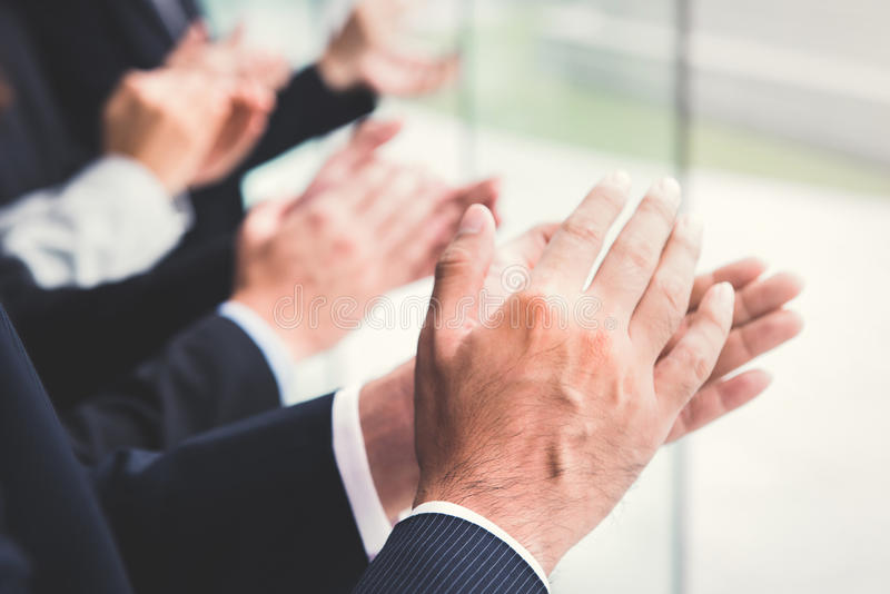 Business people clapping their hands stock images