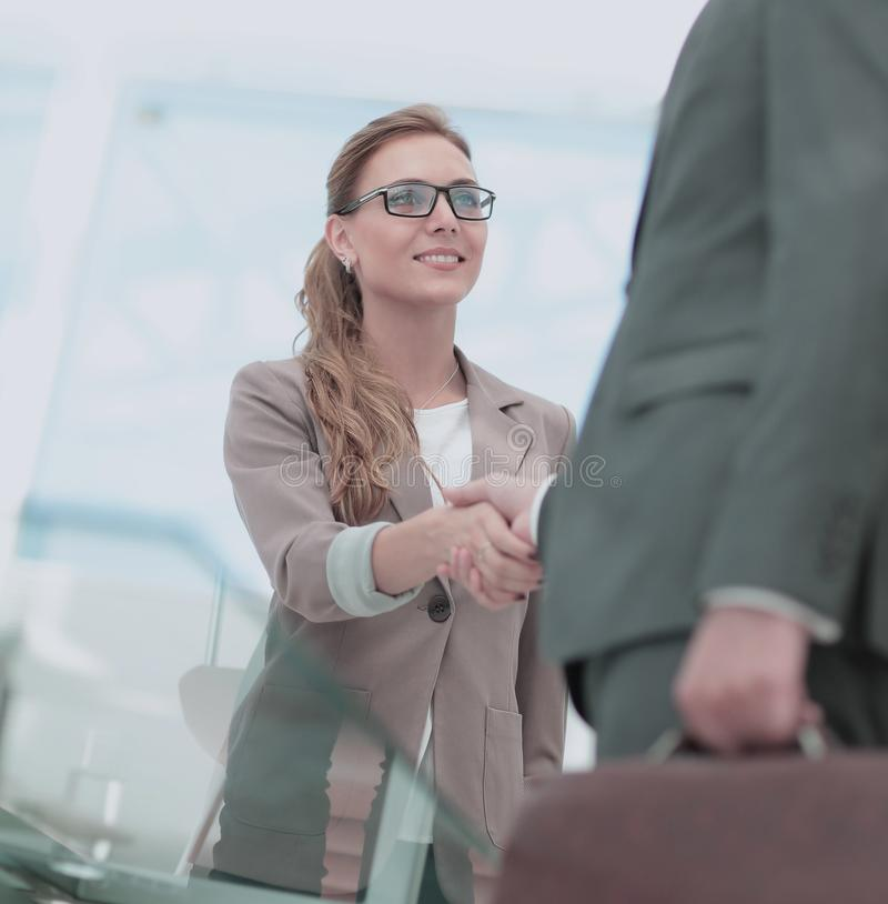 Business people closing a deal and handshaking at the office stock photos