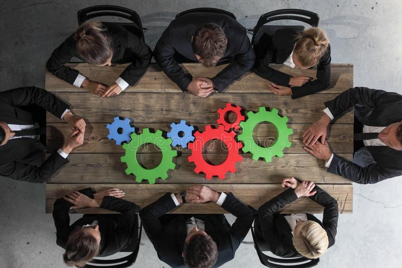 Business people with cogs of business. Business people with colorful cogs of business, problem sloution concept royalty free stock images