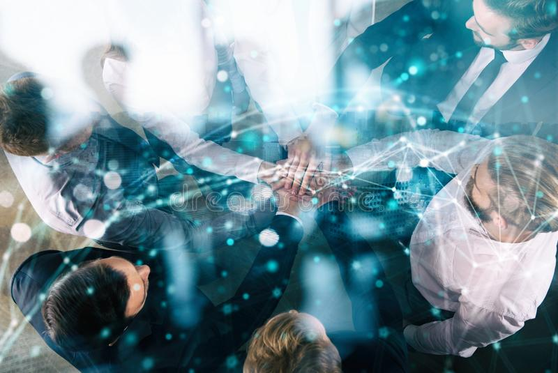 Group of young people make an agreement in the office. Double exposure with network effects. Business people collaborate together in office. Double exposure royalty free stock image