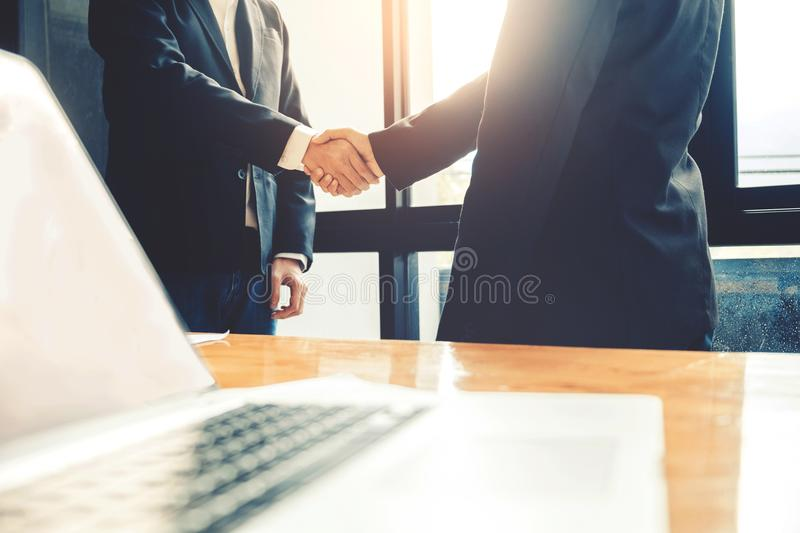 Business people colleagues shaking hands meeting Planning Strategy Analysis Concept.  royalty free stock images