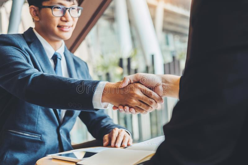 Business people colleagues shaking hands during a meeting to sign agreement for New Partner Planning Strategy Analysis Concept.  royalty free stock photography