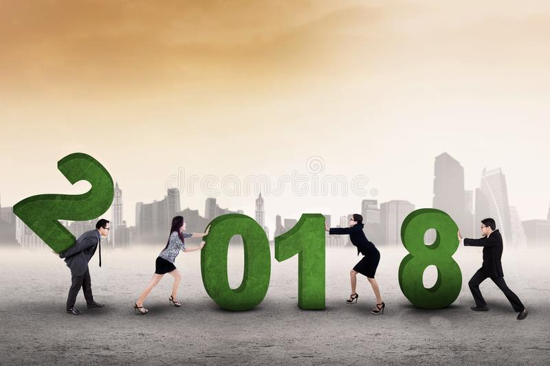 Business people compile numbers 2018 stock photography