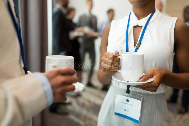 Business people with conference badges and coffee stock photos